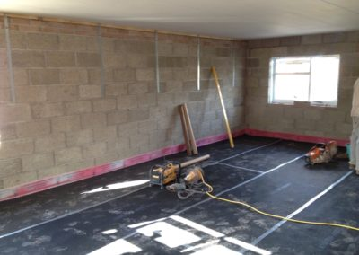 Preparing sound proof membrane and skreed flooring for development of 2 flats, Filton